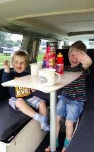 Nissan Elgrand kids on sofa area smiling-0001