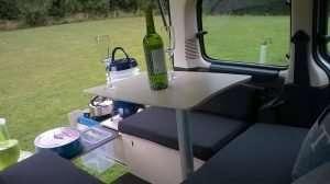 Sitting on sofa inside car on campal